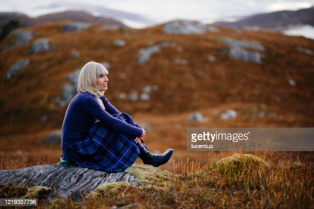 woman in tartan, scotland highlands - hill stock pictures, royalty-free photos & images