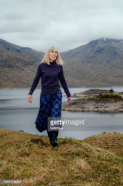 woman in tartan, scotland highlands - named wilderness area stock pictures, royalty-free photos & images