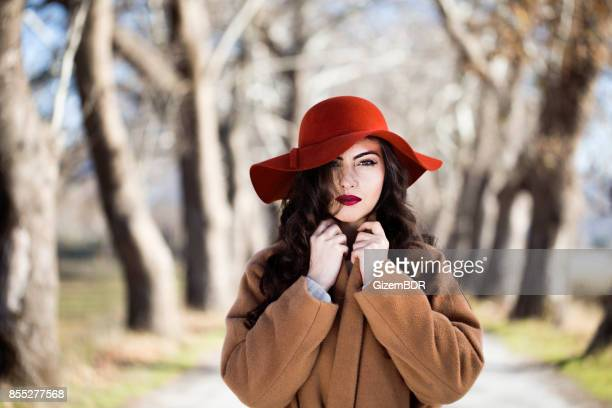 Woman in the autumn fores
