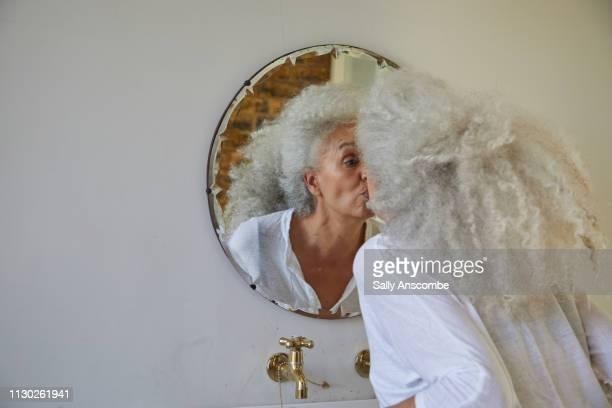 Woman in the bathroom getting ready