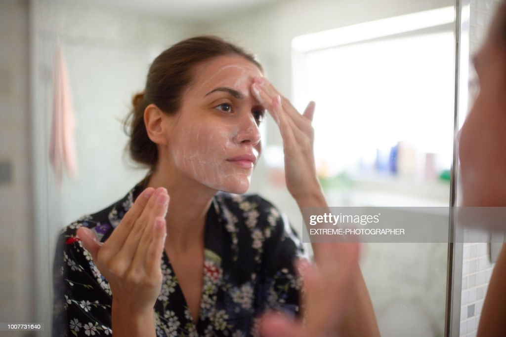 Woman in the bathroom : Stock Photo