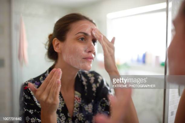 woman in the bathroom - human skin stock pictures, royalty-free photos & images