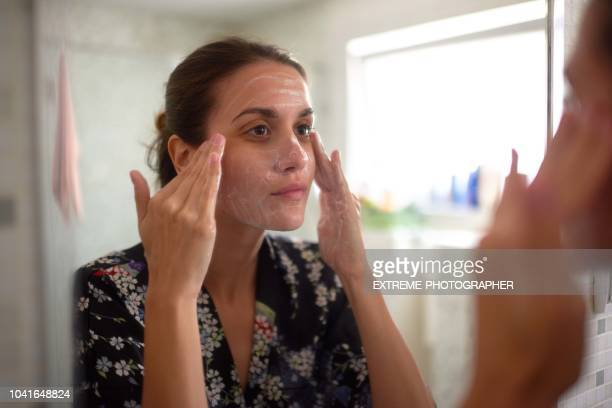 woman in the bathroom - acne stock pictures, royalty-free photos & images