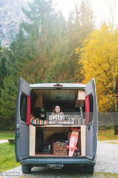 Woman in the camper van in Austrian  mountains
