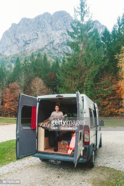 Woman in the camper van in Austrian  mountains