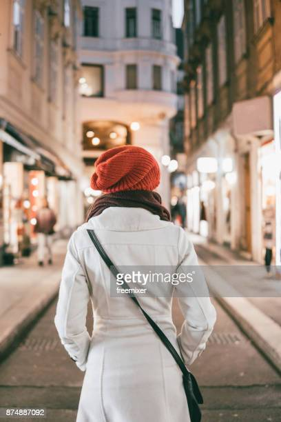 Woman in the city at night
