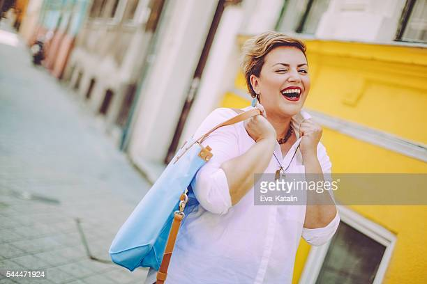 woman in the city - chubby stock photos and pictures