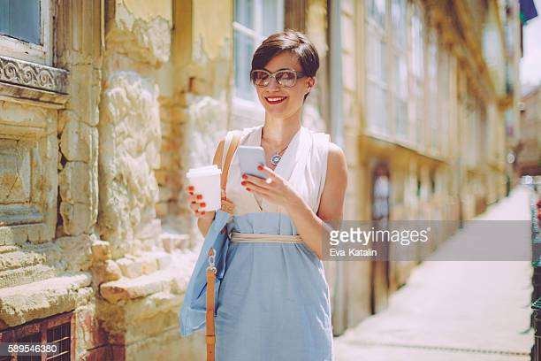 woman in the city - mid adult women stock pictures, royalty-free photos & images
