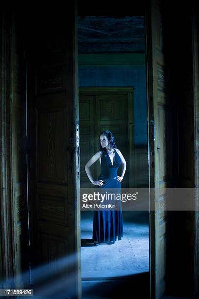 Woman in the hall of an old abandoned palace