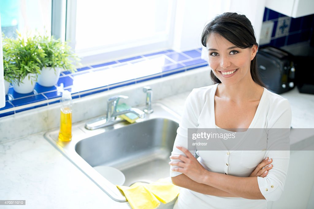 Woman In The Kitchen Washing Dishes : Stock Photo