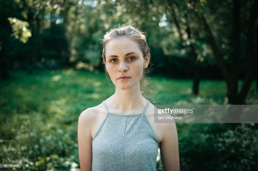 Woman in the lush foliage in springtime : Stock Photo