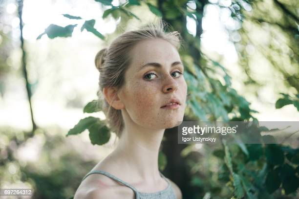 Woman in the lush foliage in springtime