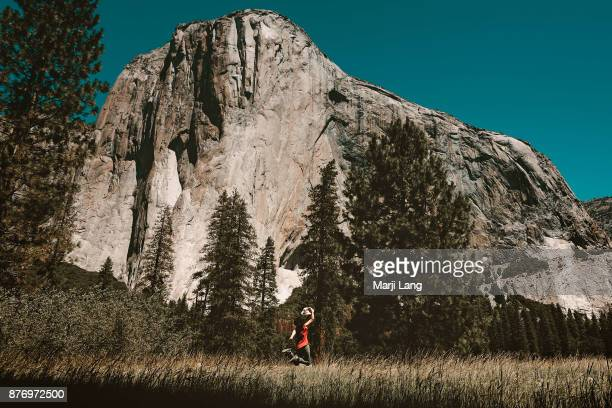 Woman in the meadow by El Capitan Yosemite National Park California USA