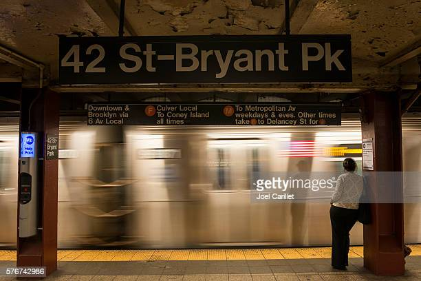 woman in the new york city subway - bryant park stock pictures, royalty-free photos & images