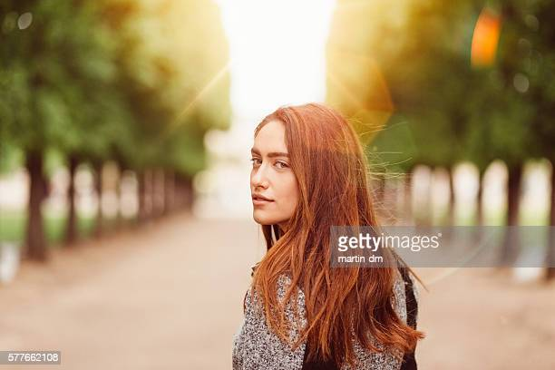 woman in the park - dyed red hair stock pictures, royalty-free photos & images