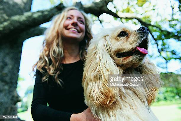 woman in the park with her cavalier king charles spaniel - under tongue stock pictures, royalty-free photos & images