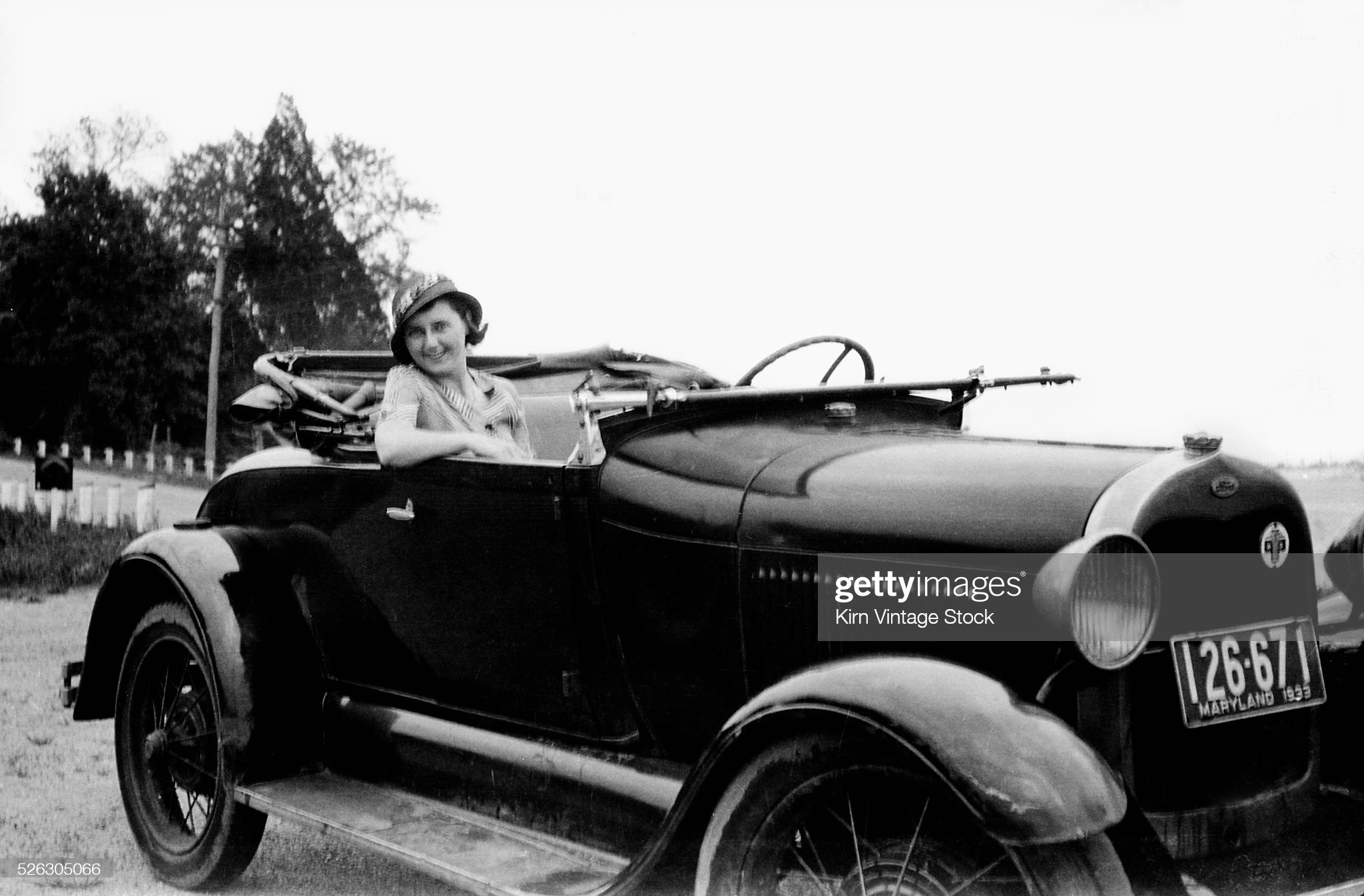 Alluring woman in a roadster in Maryland, ca. 1933. : News Photo