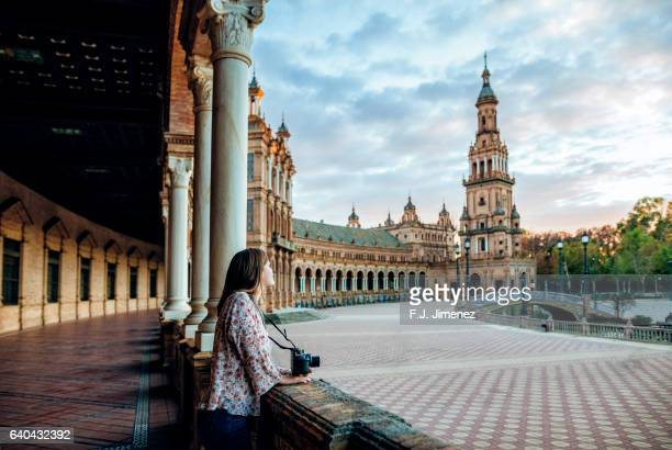 woman in the plaza de espana, seville. - seville stock pictures, royalty-free photos & images
