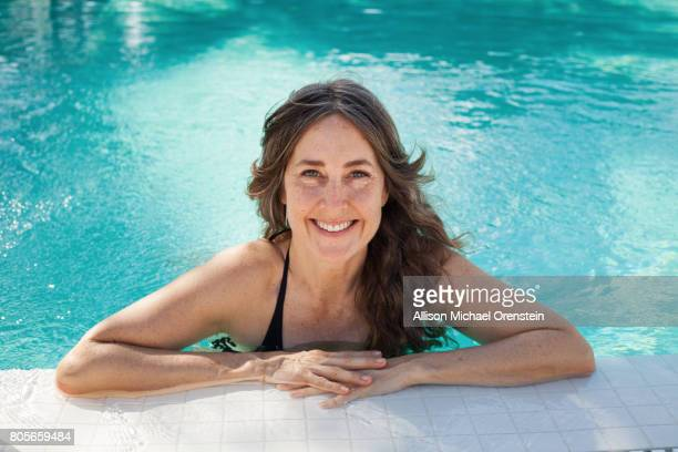 Woman in the pool smiling