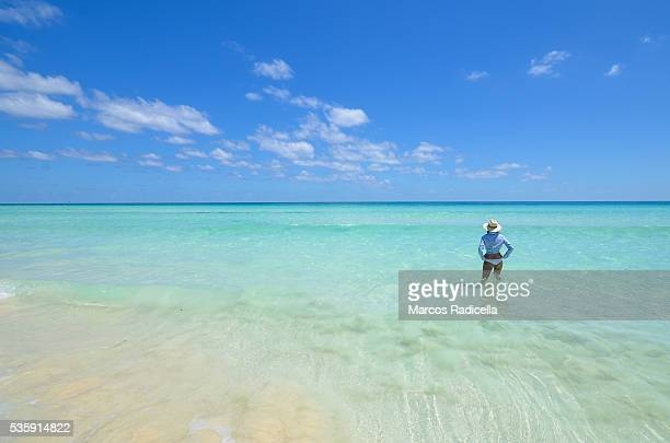 woman in the sea at cayo coco, cuba. - radicella stock photos and pictures