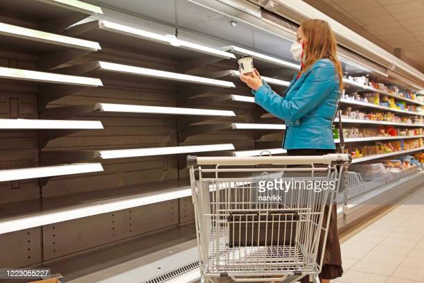 woman in the shop at empty shelves - sold out stock pictures, royalty-free photos & images