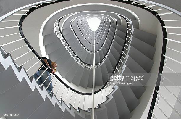 Woman in the staircase of the Oberfinanzdirektion in Frankfurt / Main Symbolic photo to the topics economic situation economic progress etc
