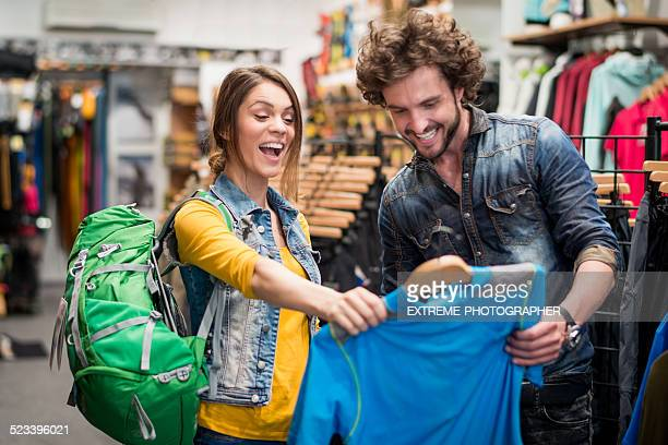 Woman in the store is happy to find blue shirt