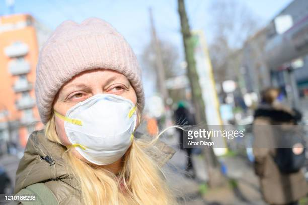 woman in the street wearing a protection mask.  germany. - 1918 flu pandemic stock pictures, royalty-free photos & images