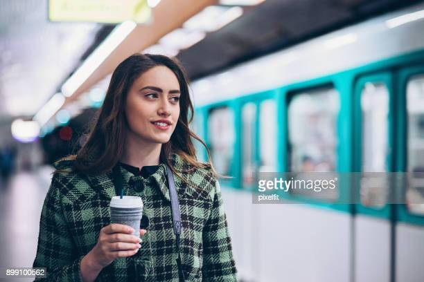 woman in the subway - subway train stock pictures, royalty-free photos & images