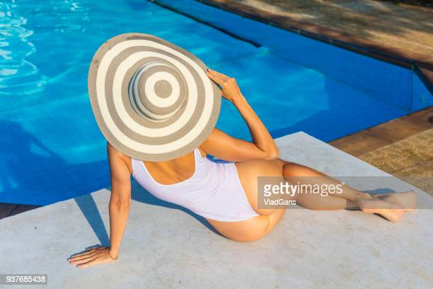 woman in the swimming pool - sun hat stock pictures, royalty-free photos & images