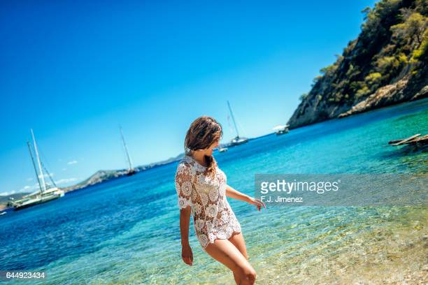 Woman in the water at Llentrisca Beach in Ibiza
