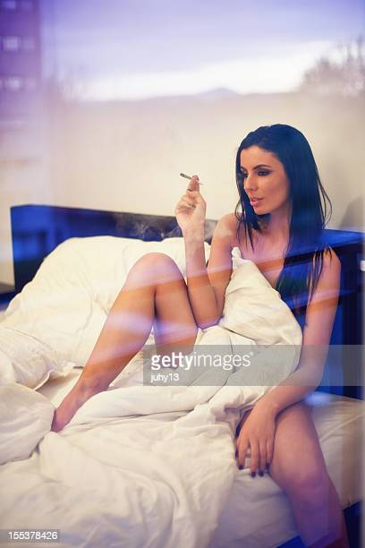 woman in the window - smoking weed stock photos and pictures