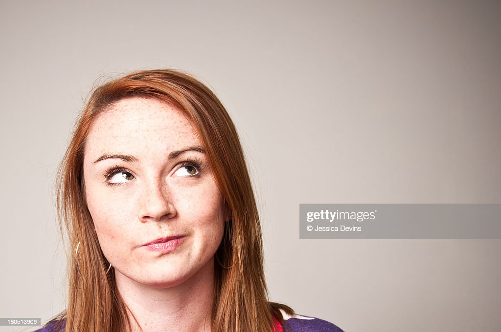 Woman in thought, scrunched lips : Stock Photo
