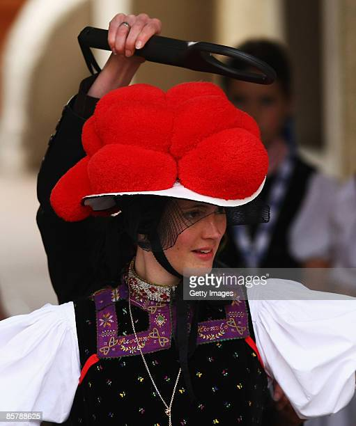 A woman in traditional 'Black Forest' clothes is pictured upon Obamas arrival for bilateral talks on April 3 2009 in Baden Baden Germany The two...
