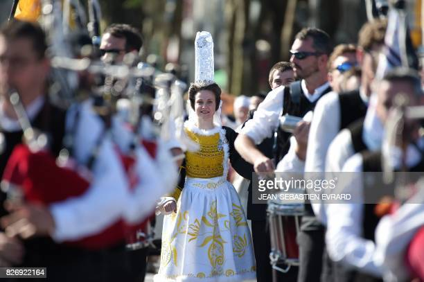 A woman in traditional Breton outfits takes part in the traditional street parade of the 47th Lorient Interceltic Festival on August 6 2017 in...