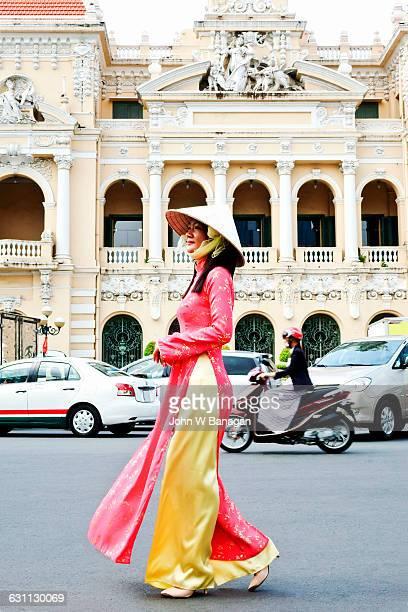 Woman in traditional clothes , Saigon, HCM city