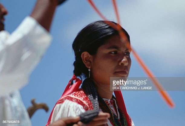 Woman in traditional costume during the celebrations at the Guelaguetza festival Oaxaca Mexico