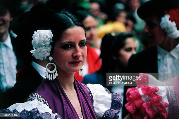 Woman in traditional costume during the pilgrimage in honor of Our Lady of El Rocio Almonte Andalusia Spain