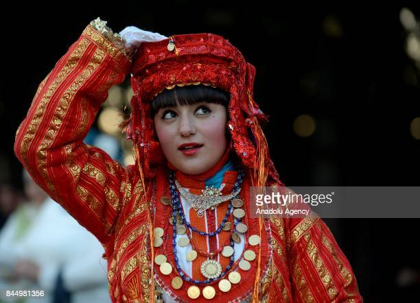 A woman in traditional dress takes part in a Macedonian indigenous Juruk tribe wedding in Pochival Village near Stip Macedonia on September 8 2017...