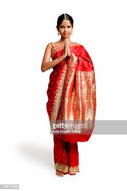 woman in traditional indian costume, standing with hands together - prayer pose greeting bildbanksfoton och bilder