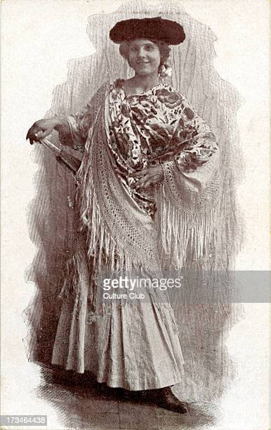 Woman in traditional Spanish dress She is wearing a shawl and holding a fan
