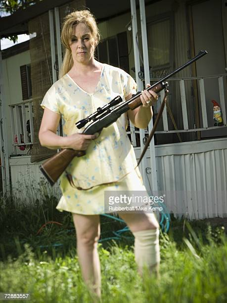 woman in trailer park with a rifle - redneck woman stock photos and pictures