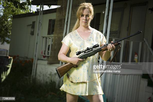 woman in trailer park with a rifle - redneck stock photos and pictures