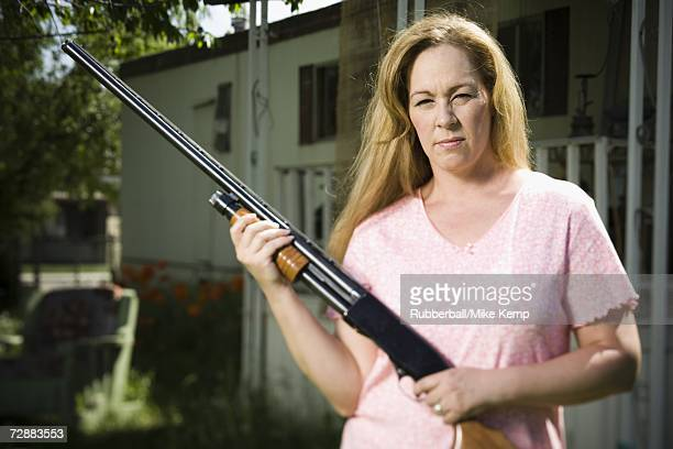 woman in trailer park with shotgun - redneck woman stock photos and pictures