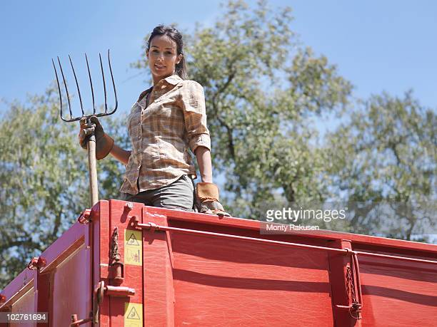 Woman in trailer with fork