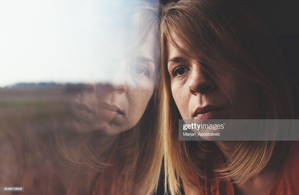 Woman in train alone and sad : Stock Photo