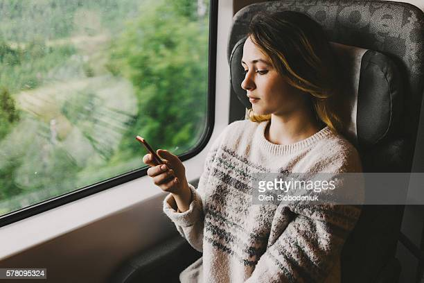 Woman in train with smartphone