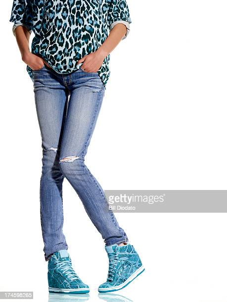 Woman in trendy matching jeans and sneakers