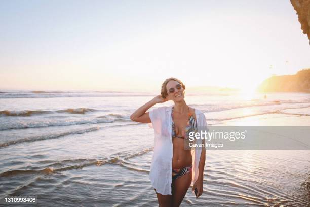 woman in tropical  bikini on the beach at sunset - pismo beach stock pictures, royalty-free photos & images