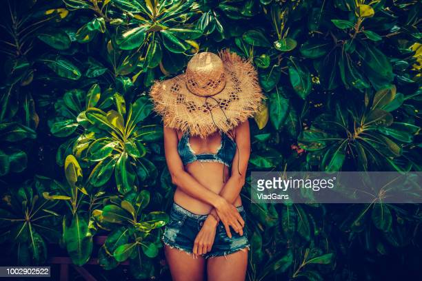 woman in tropical - green shorts stock photos and pictures
